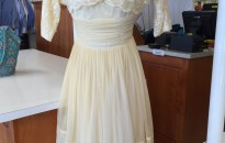 After; the same vintage gown restored.